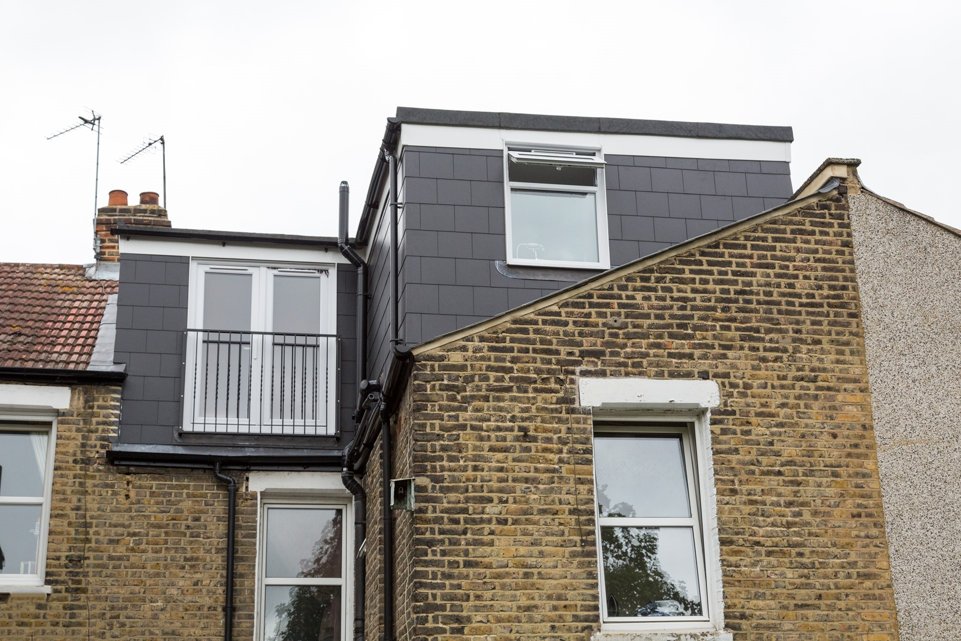shaped Dormer Loft Conversion - Simply Loft